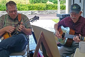 Scott Freeman and Willard Gayheart playing mandolin and guitar